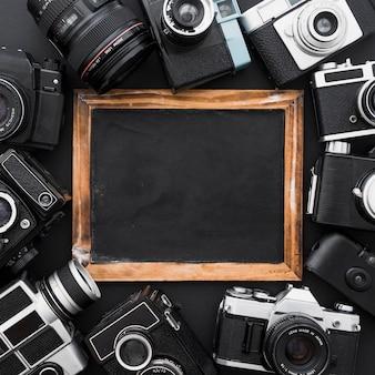 Assorted cameras around blackboard