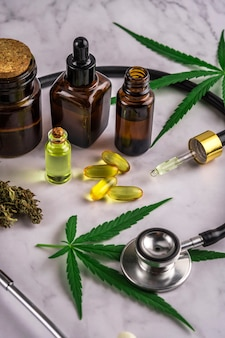 Assorted cannabis products, pills and cbd oil over medical prescription sheet