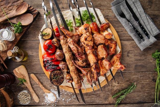 Assorted caucasian shashlik skewers and kebabs