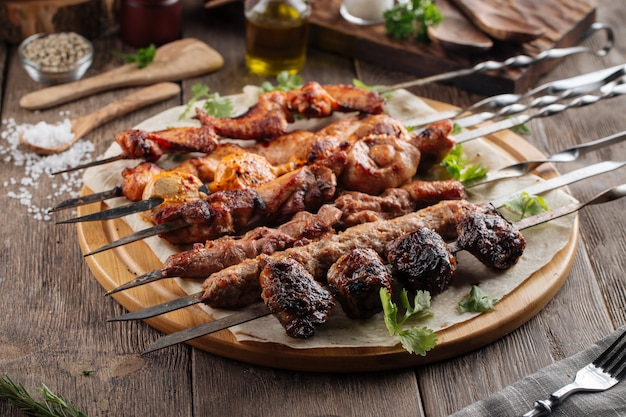 Assorted caucasian shashlik skewers and kebabs