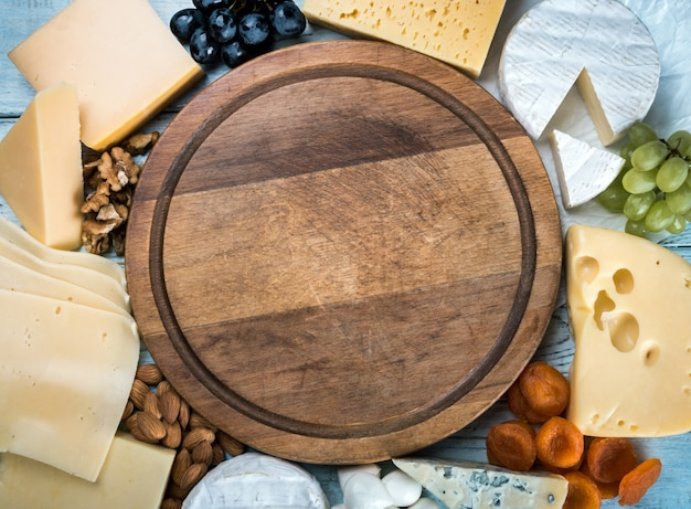 Assorted cheeses, soft, hard, rennet and brine with fruits, nuts and dried fruits