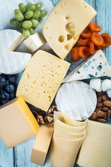 Assorted cheeses, soft, hard, rennet and brine with fruits, nuts
