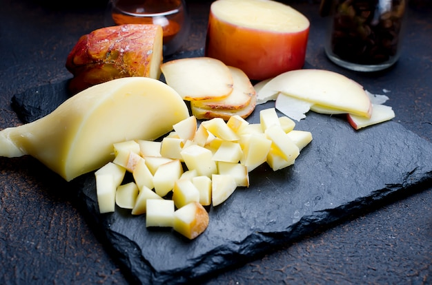Assorted cheeses in various shapes and sizes