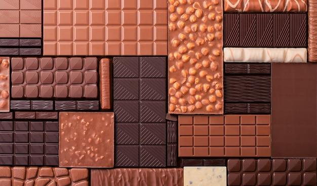 Ассорти шоколадных конфет, различные плитки какао. фон органических продуктов питания.