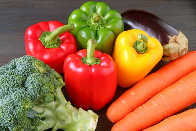 Assorted colorful fresh vegetables on a wooden table