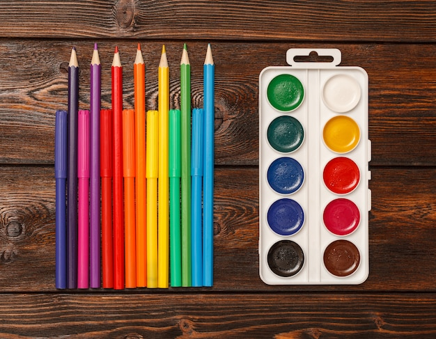 Assorted colors marker pens and pencils with watercolors