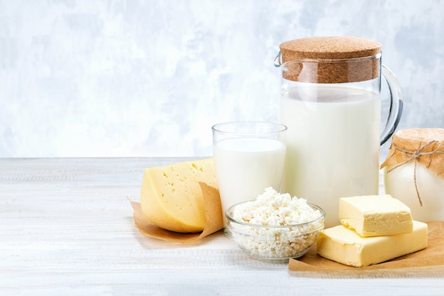 Assorted dairy product on grey table with space for text.
