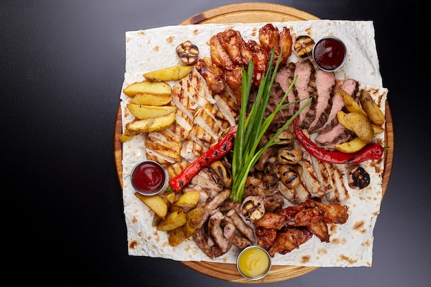 Assorted delicious grilled meat with vegetable. top view.