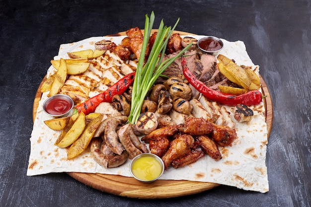 Assorted delicious grilled meat with vegetable.