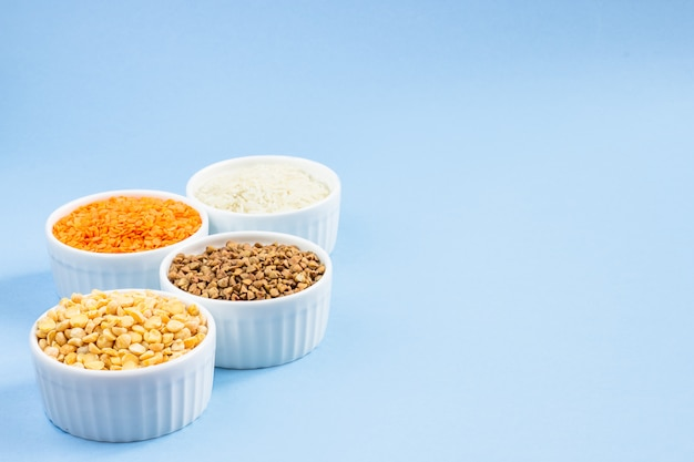 Assorted different cereals on blue