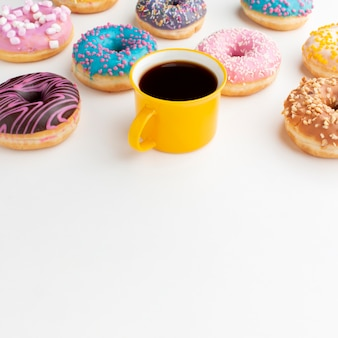 Assorted donuts and coffee copy space