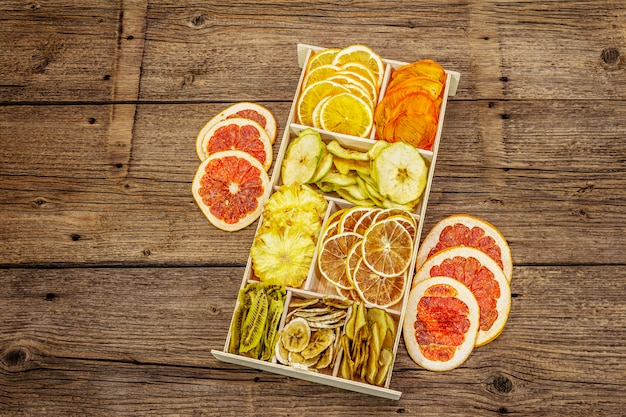 Assorted dried fruits. healthy eating concept. wooden box