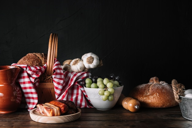 Assorted food and basket on table