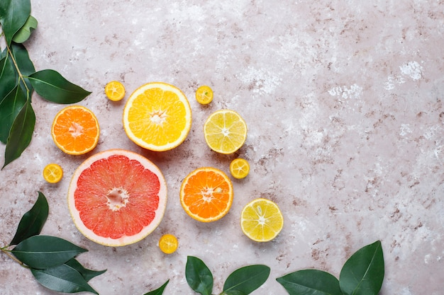 Assorted fresh-citrus fruits,lemon,orange,lime,mandarin,kumquat,grapefruit fresh and colorful,top view
