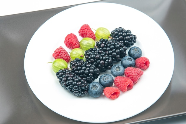 Assorted fresh different berries on a white background. useful vitamin healthy food fruit. healthy vegetable breakfast