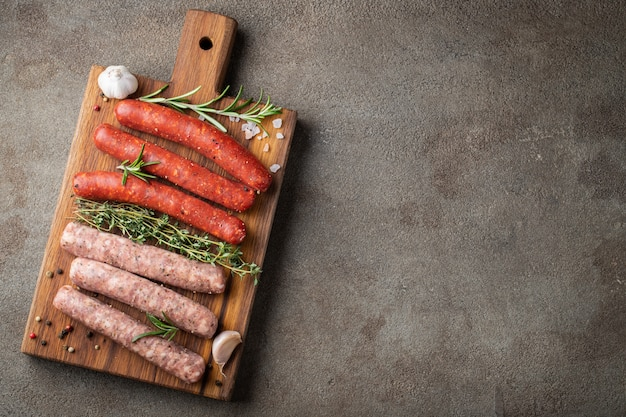 Assorted fresh raw sausages.
