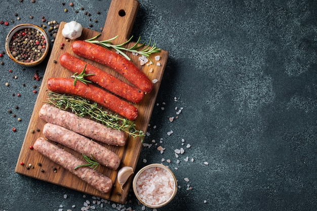 Assorted fresh sausages with thyme, rosemary.