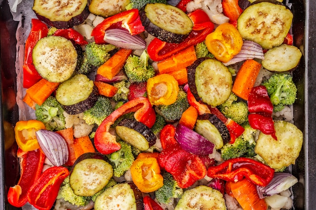 Assorted fresh vegetables on a baking sheet. healthy food lifestyle. salt, oil, spices