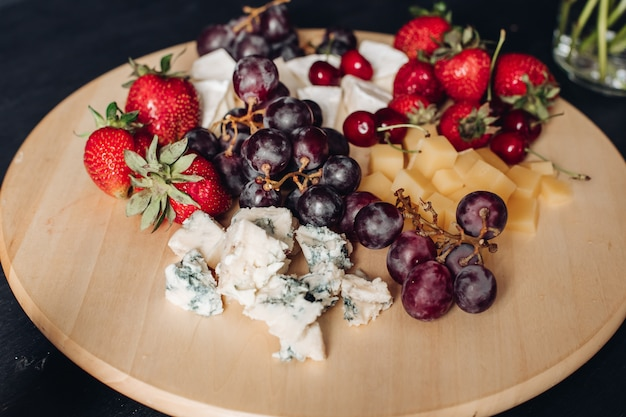 Assorted fruit and cheese plate.close-up of delicious food plate