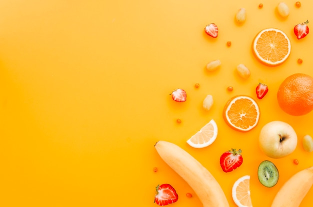 Assorted fruit on yellow background