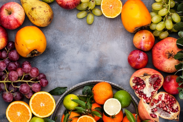 Assorted fruits on a gray background
