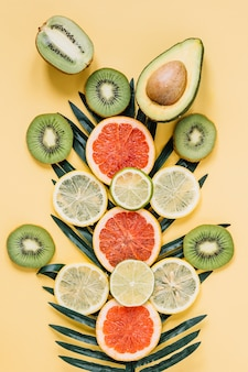 Assorted fruits near palm leaf