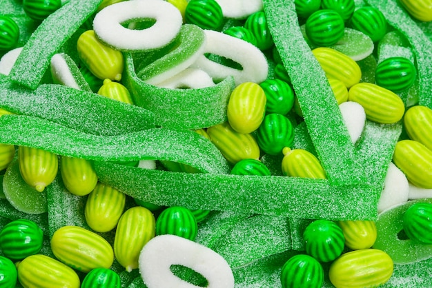 Assorted green gummy candies background. top view. jelly  sweets.