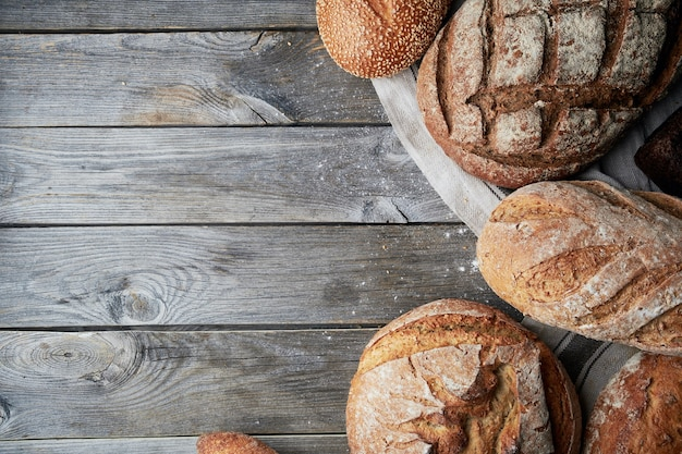 Assorted homemade glutenfree and yeastfree bread on grey wooden background