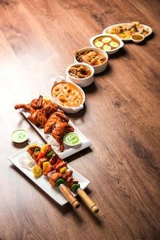 グループで提供される各種インドの非ベジタリアン料理のレシピ。チキンカレー、マトンマサラ、アンダまたはエッグカレー、バターチキン、ビリヤニ、タンドリーチキン、チキンティッカとナア、ラマダンのロティが含まれています