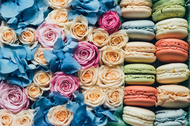 Assorted macaroon and flowers in a box