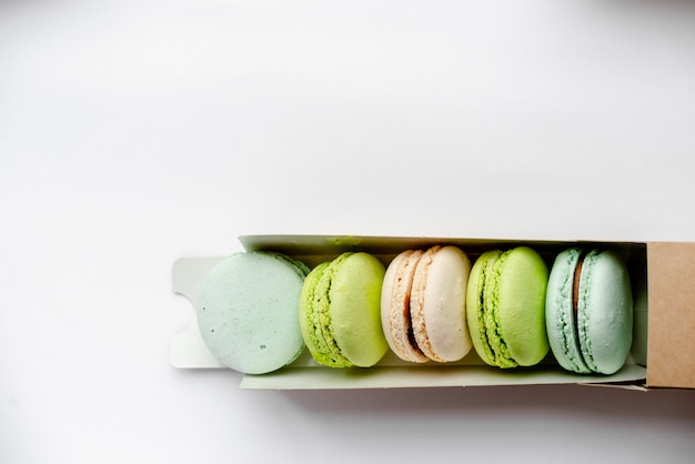 Assorted macaroons in craft paper box