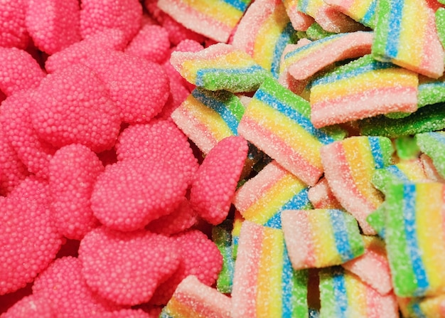 Assorted many colorful tasty gummy candies. sweets background.