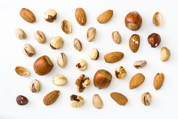 Assorted mixed nuts pattern isolated on white background top view