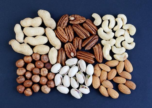 Assorted mixed nuts, peanuts, almonds, walnuts, pistachios, pecan, cashew, hazelnuts.