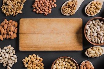 Assorted nuts around board