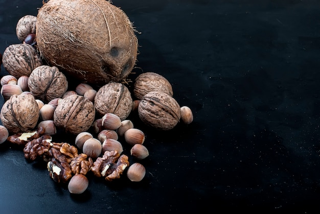 Assorted nuts on a black background