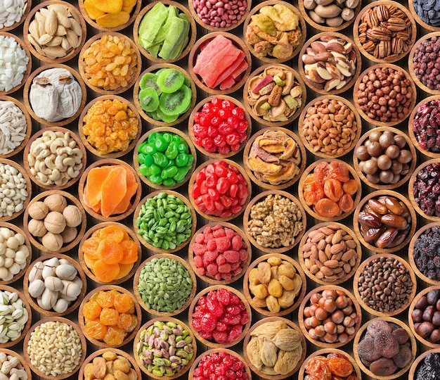 Assorted nuts and dried fruit background.