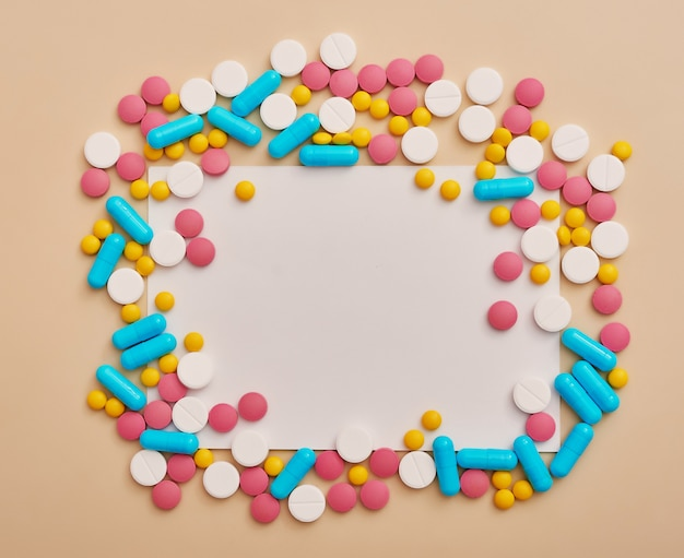 Assorted pharmaceutical medicine pills, tablets and capsules on beige background. medicine concept and health