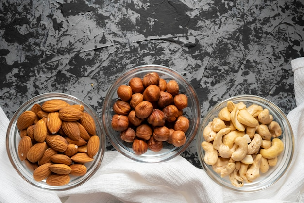 Assorted raw nuts in a bowl top view, cashew nuts, almonds, hazelnuts at the kitchens