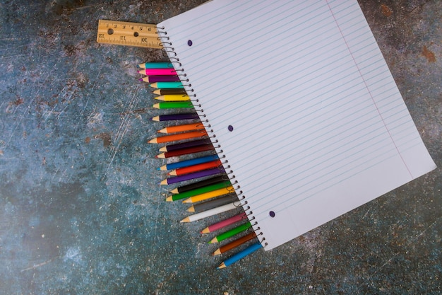 Assorted school supplies with a pencils, ruler, notebook