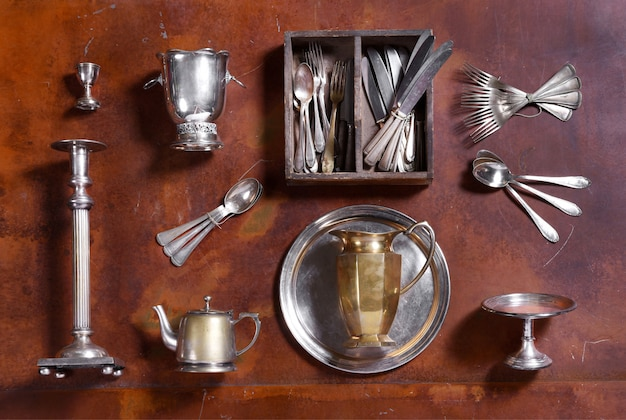 Assorted silver kitchenware arranged on wood