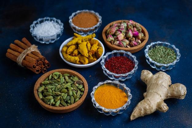 Assorted spices on dark black