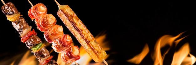 Assorted steak skewers on fire