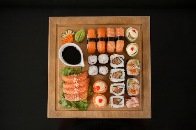 Assorted sushi set served on wooden tray