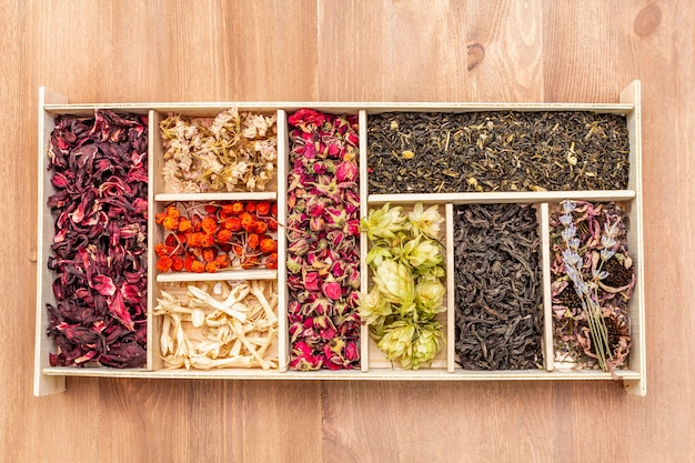 Assorted tea leaves, dried berries and flowers. healthy drink concept.
