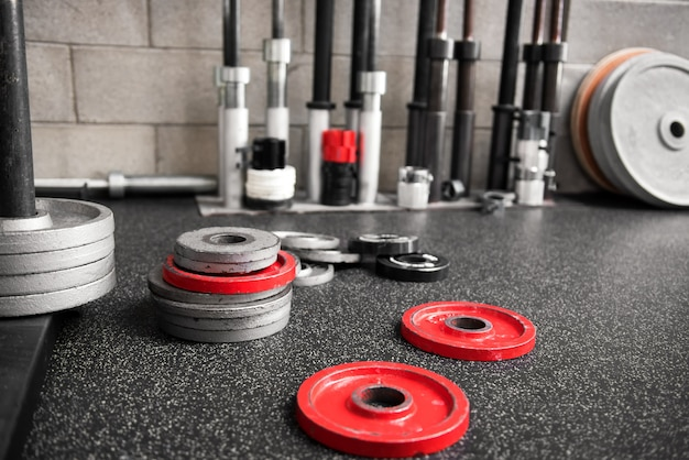 Assorted weights scattered on the floor of a gym