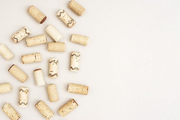 Assorted wine corks from white and red vine on paper background with empty space for your text. top view and flat lay.