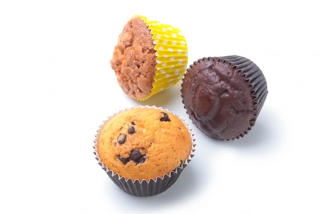 Assorted with delicious homemade cupcakes with raisins and chocolate isolated