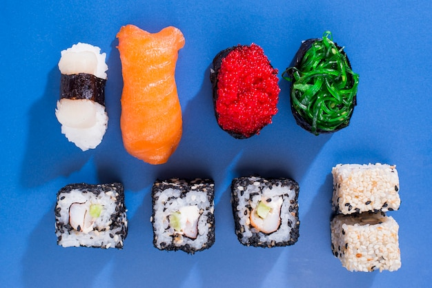 Assortiments of sushi rolls on table
