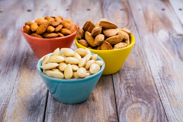 Assortment of almond nuts - peeled and fried, unpeeled and almonds in shells